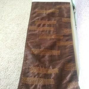 Brown satiny table runner